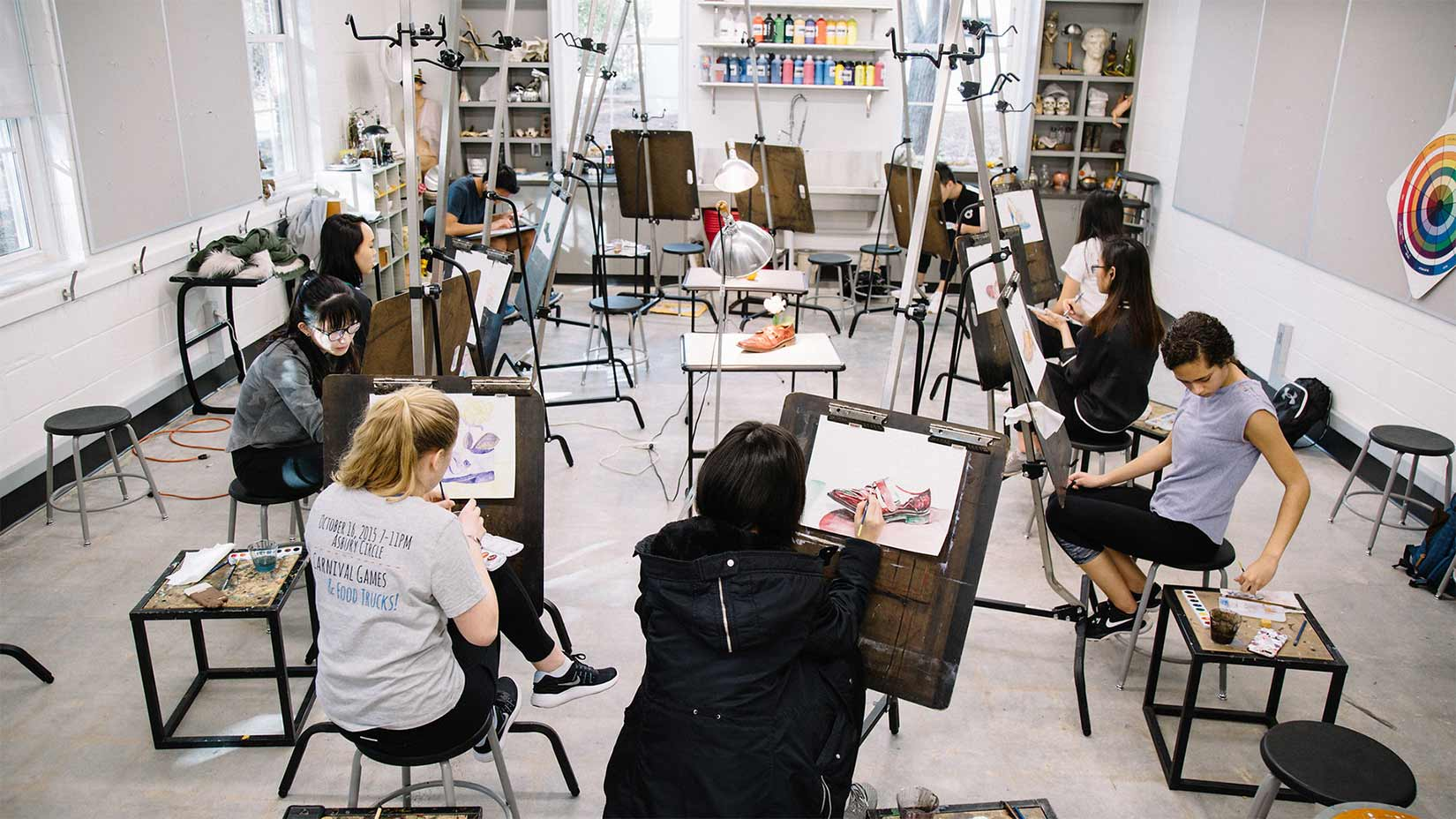 Students work on their paintings in art studio in Pierce Hall.