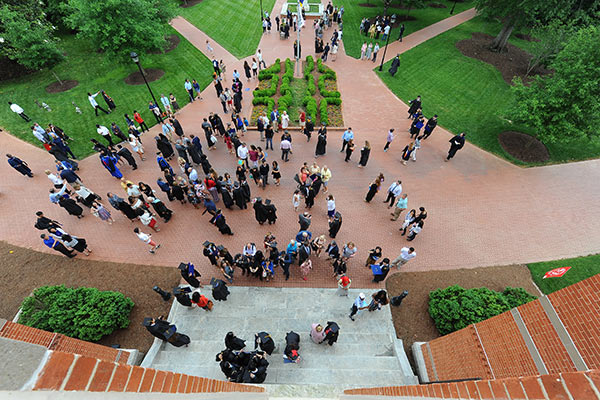 Students and families celebrate Commencement on the quad.