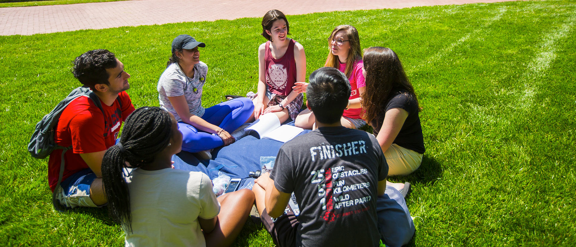 Students sit on the quad outside the Oxford library.