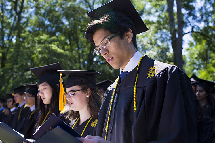 Oxford students take part in commencement ceremonies on the Oxford quad.