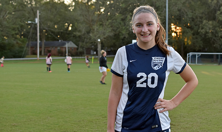 Annie Chappell wears wears the No. 20 jersey, the same as her dad's baseball number at Emory.