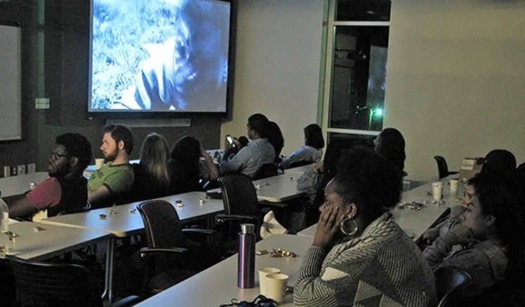 Students watch I Am Not Your Negro at the inaugural film screening.