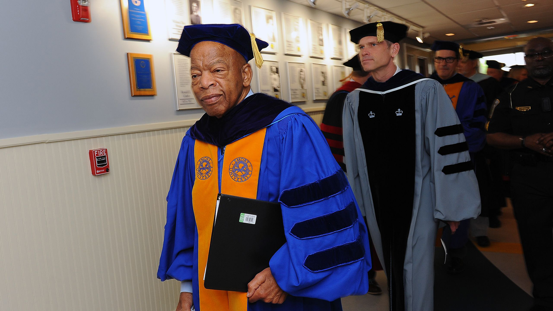 U.S. Rep. John Lewis walks toward the gym for Oxford's Commencement.